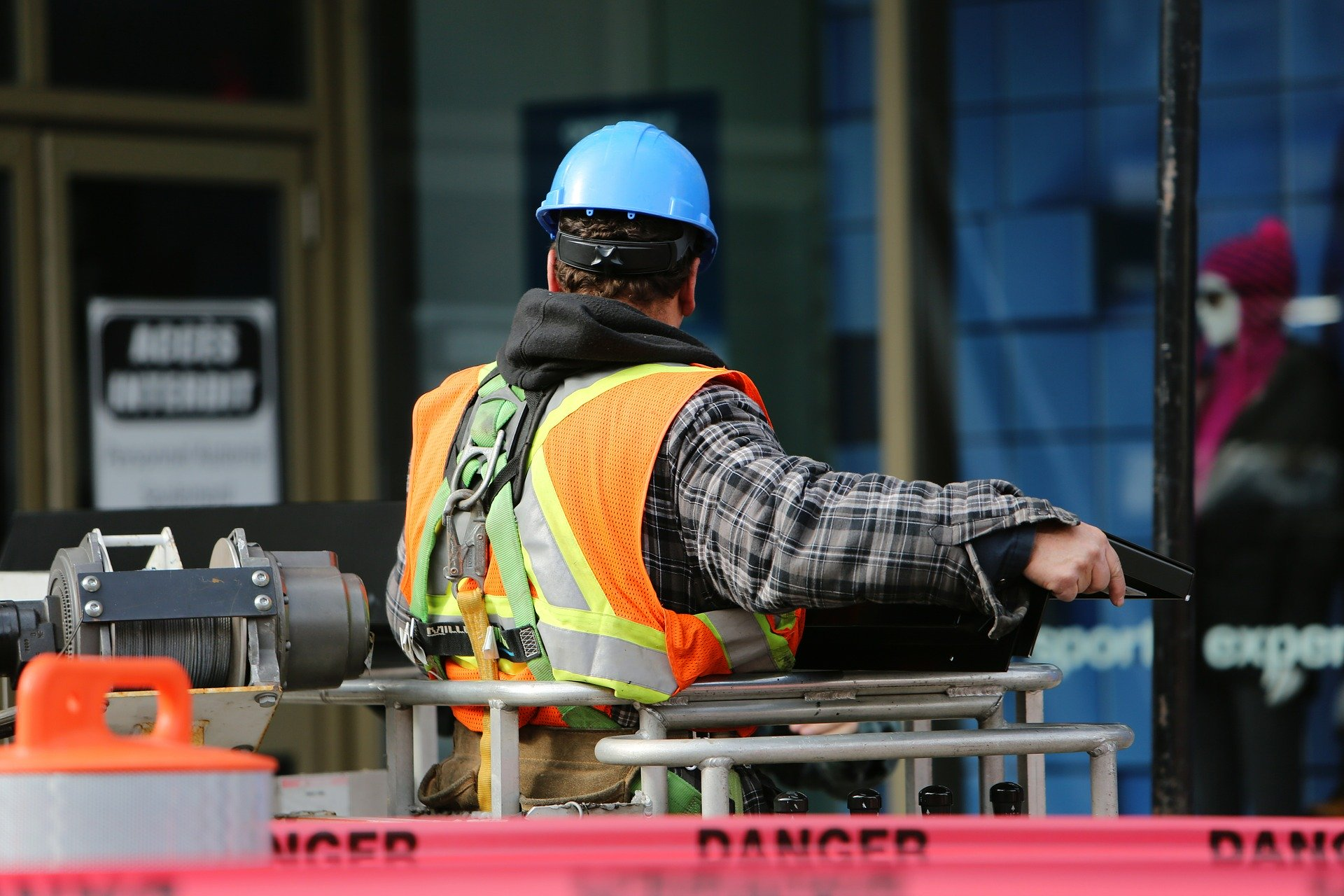 A contractor wearing protective equipment on a construction site