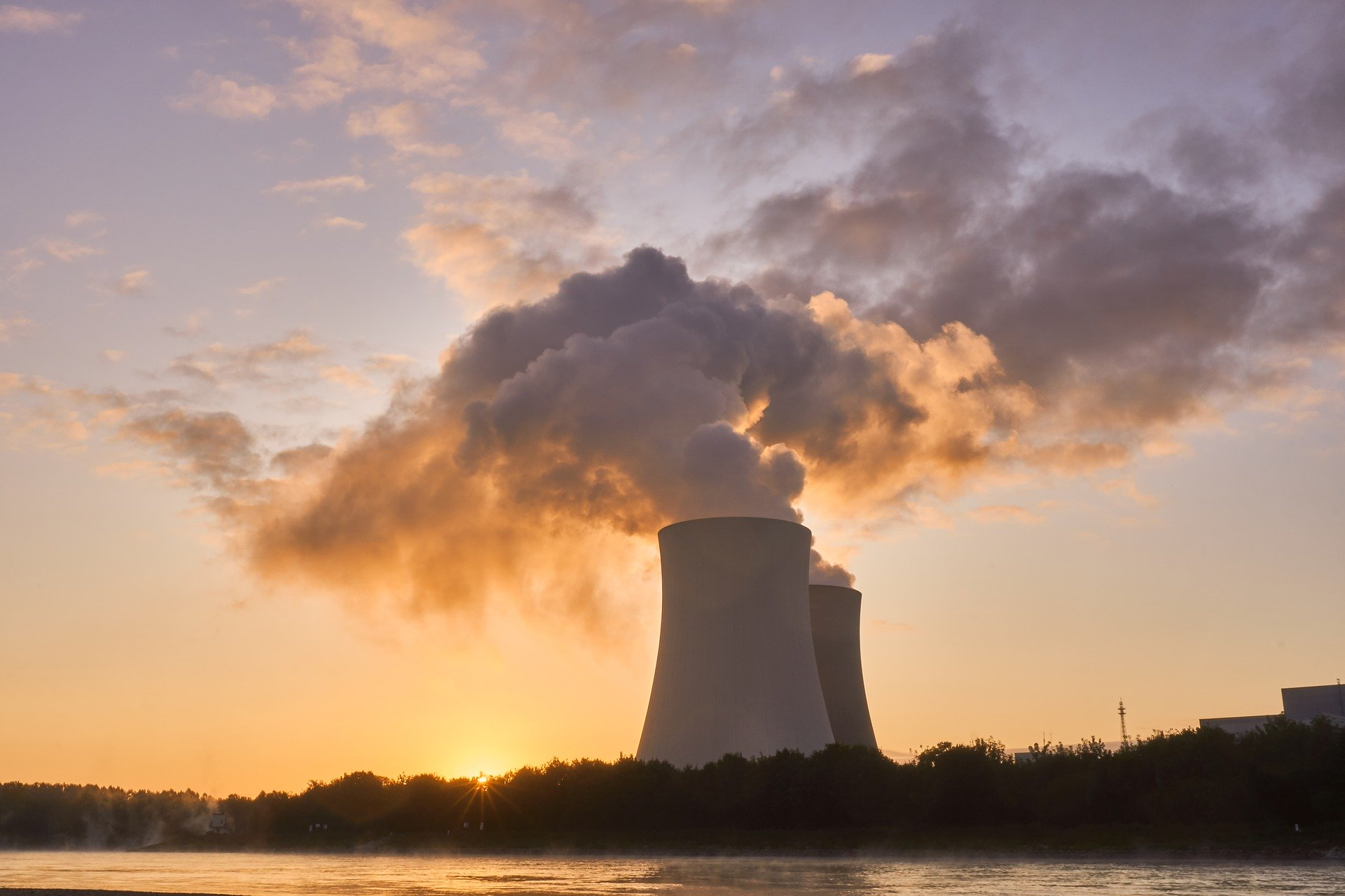 A nuclear power station in front of a sunset